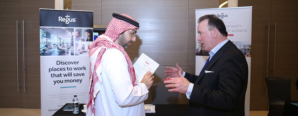 Two men are stood having a discussion at the Regus 8th Middle East Business & IT Resilience Summit in Dubai